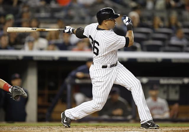 New York Yankees Carlos Beltran hits a third-inning, two-run, home run off Boston Red Sox starting pitcher Felix Doubront in the MLB American League baseball game at Yankee Stadium in New York, Sunday, April 13, 2014. (AP Photo/Kathy Willens)