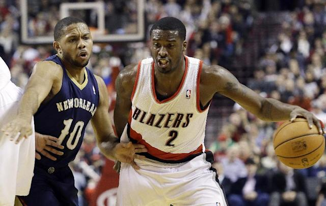 Portland Trail Blazers guard Wesley Matthews, right, drives past New Orleans Pelicans guard Eric Gordon during the first half of an NBA basketball game in Portland, Ore., Saturday, Dec. 21, 2013. (AP Photo/Don Ryan)