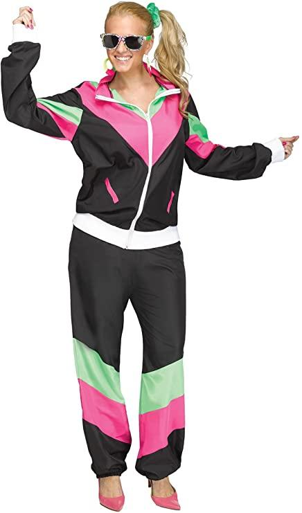 Woman dressed in black, pink and green 80's Track Suit costume with side ponytail and sunglasses
