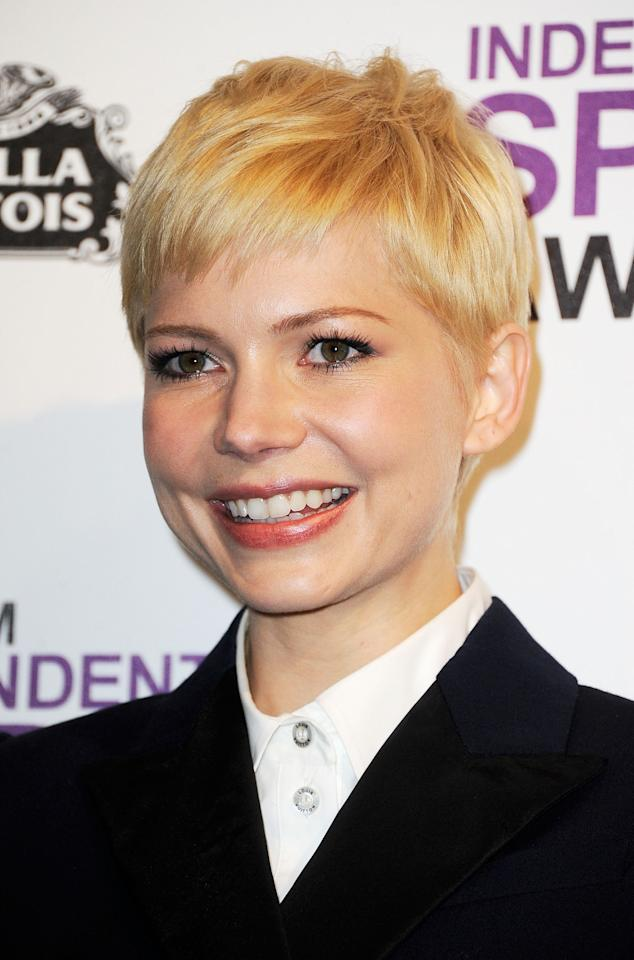 "SANTA MONICA, CA - FEBRUARY 25:  Actress Michelle Williams poses with the award for Best Female Lead for ""My Week With Marilyn"" in the press room at the 2012 Film Independent Spirit Awards on February 25, 2012 in Santa Monica, California.  (Photo by Frazer Harrison/Getty Images)"