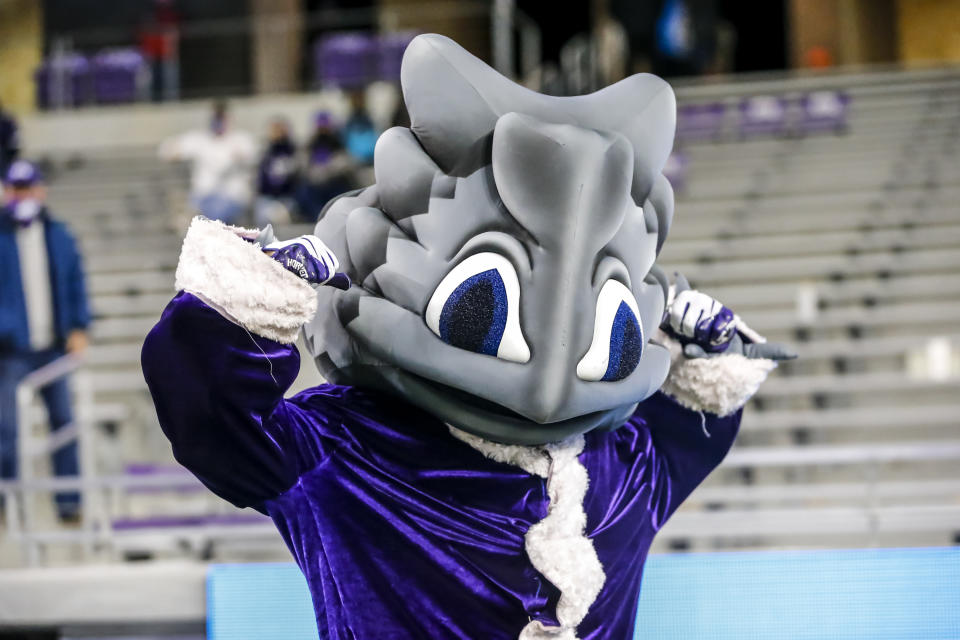 "FORT WORTH, TX - DECEMBER 12: The TCU Horned Frogs mascot ""Superfrog"" poses for pictures dressed as Santa Claus during the game between the TCU Horned Frogs and the Louisiana Tech Bulldogs on December 12, 2020 at Amon G. Carter Stadium in Fort Worth, Texas. (Photo by Matthew Pearce/Icon Sportswire via Getty Images)"
