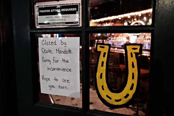 PHOTO: A restaurant posts a closed sign in the early evening in Brooklyn after a decree that all bars and restaurants shutdown by 8 pm, in New York City, on March 16, 2020, as much of the nation takes extra precautions due to the coronavirus outbreak. (Spencer Platt/Getty Images)