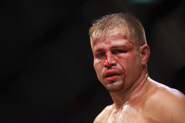 Fabio Maldonado, from Brazil, reacts after being defeated by countryman Glover Teixeira, during their light heavyweight mixed martial arts bout at UFC 153 in Rio de Janeiro, early Sunday, Oct. 14, 2012. (AP Photo/Felipe Dana)