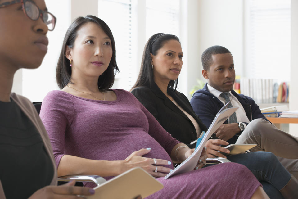 A pregnant woman in an office situation