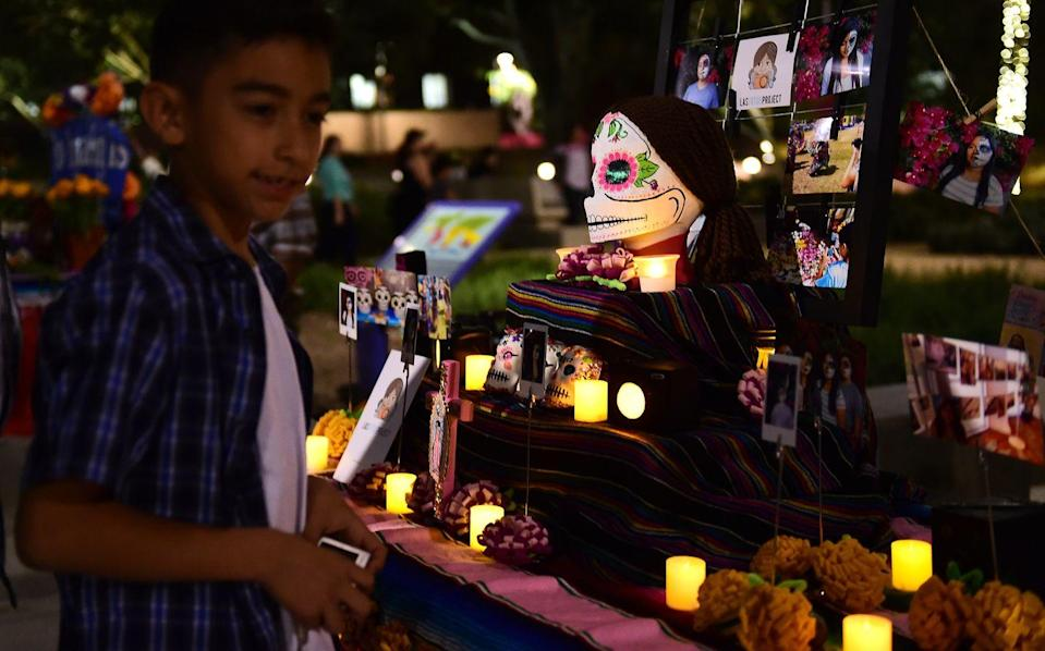 "<p>Core to Dia de Muertos is <a href=""https://dayofthedead.holiday/traditions/the-ofrenda"" rel=""nofollow noopener"" target=""_blank"" data-ylk=""slk:the ofrenda"" class=""link rapid-noclick-resp"">the ofrenda</a>, or the altar created to honor the dead. A typical ofrenda is a table that's adorned with traditional pastries and marigold petals, as well as items identified with the deceased, like photos or other personal items.</p>"