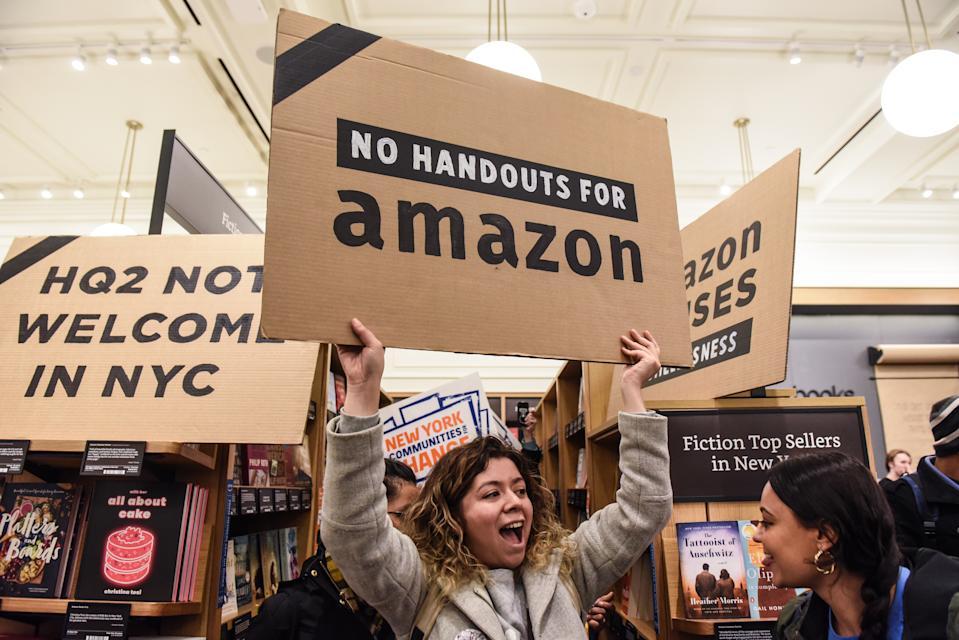 NEW YORK, NY - NOVEMBER 26: People opposed to Amazon's plan to locate a headquarters in New York City hold a protest inside of an Amazon book store on 34th. St. on November 26, 2018 in New York City. Amazon recently announced that New York City will become one of two locations that will house Amazon's second North American headquarters, known as HQ2. (Photo by Stephanie Keith/Getty Images)