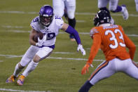 Minnesota Vikings wide receiver Adam Thielen (19) runs with the ball as Chicago Bears cornerback Jaylon Johnson (33) defends during the first half of an NFL football game Monday, Nov. 16, 2020, in Chicago. (AP Photo/Nam Y. Huh)