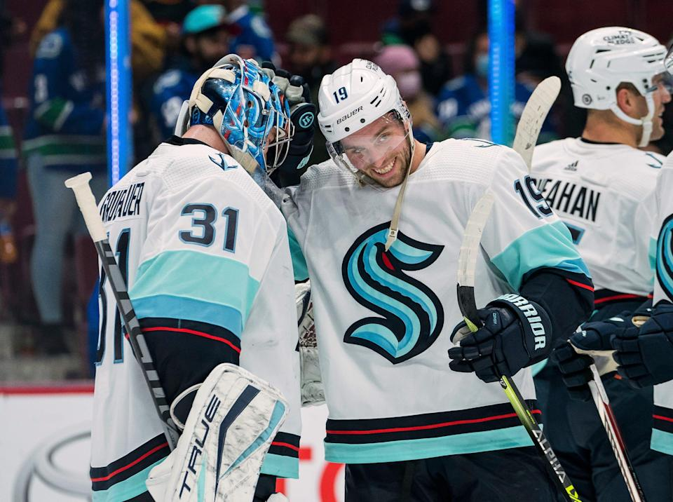 Oct 5, 2021; Vancouver, British Columbia, CAN; Seattle Kraken goalie Philipp Grubauer (31) and forward Calle Jarnkrok (19) celebrate after defeating the Vancouver Canucks at Rogers Arena. Seattle won 4-0. Mandatory Credit: Bob Frid-USA TODAY Sports