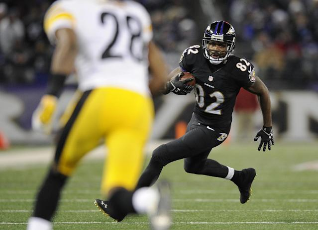 Baltimore Ravens wide receiver Torrey Smith (82) rushes the ball toward Pittsburgh Steelers cornerback Cortez Allen in the second half of an NFL football game on Thursday, Nov. 28, 2013, in Baltimore. (AP Photo/Nick Wass)