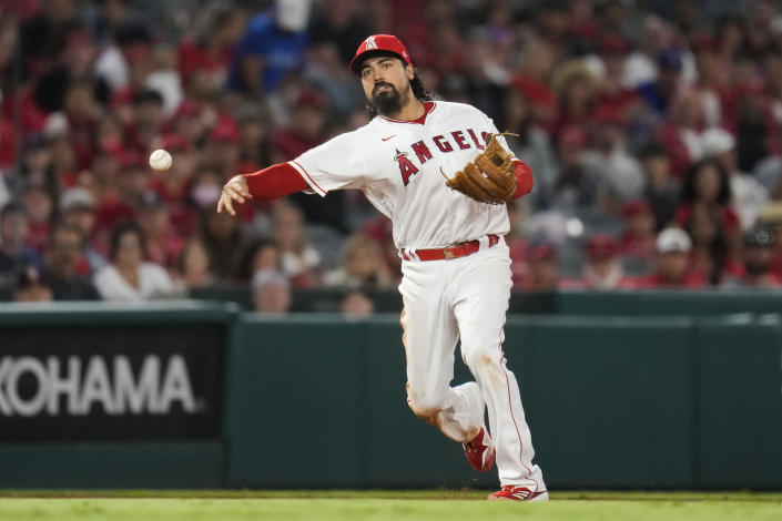 Los Angeles Angels third baseman Anthony Rendon (6) throws to first base to out Baltimore Orioles' Trey Mancini during the sixth inning of a baseball game Friday, July 2, 2021, in Anaheim, Calif. (AP Photo/Ashley Landis)
