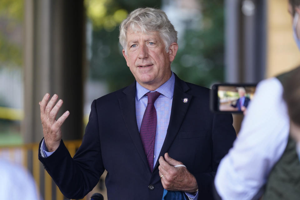 Virginia Attorney General Mark Herring gestures as he speaks to the media after a court hearing on a lawsuit on the removal of the statue of Confederate General Robert E. Lee at Richmond General district Court in Richmond, Va., Monday, Oct. 19, 2020. (AP Photo/Steve Helber)