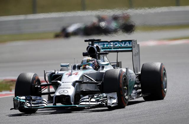 Britain's Lewis Hamilton of Mercedes rounds the track during a practice session before the British Formula One Grand Prix at Silverstone circuit, Silverstone, England, Friday, July 4, 2014. The British Formula One Grand Prix will be held on Sunday, July 6, 2014. (AP Photo/Lefteris Pitarakis)
