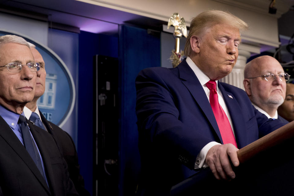"FILE - In this Feb. 29, 2020 file photo, President Donald Trump, accompanied by, from left, National Institute for Allergy and Infectious Diseases Director Dr. Anthony Fauci, Vice President Mike Pence, and Robert Redfield, director of the Centers for Disease Control and Prevention, reacts to a question during a news conference on the coronavirus in the press briefing room at the White House in Washington. Public health officials were already warning Americans about the need to prepare for the coronavirus threat in early February when President Donald Trump called it ""deadly stuff"" in a private conversation that has only now has come to light. (AP Photo/Andrew Harnik, File)"