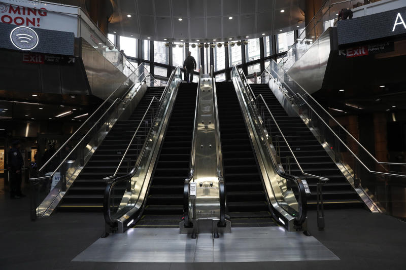 Image: A lone person enters an empty Fulton subway station during the evening rush, as people react to coronavirus disease (COVID-19) in New York (Lucas Jackson / Reuters)