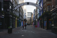 General view of a near empty Carnaby Street, in London, Saturday, Jan. 9, 2021, during England's third national lockdown to curb the spread of coronavirus. (AP Photo/Alberto Pezzali)