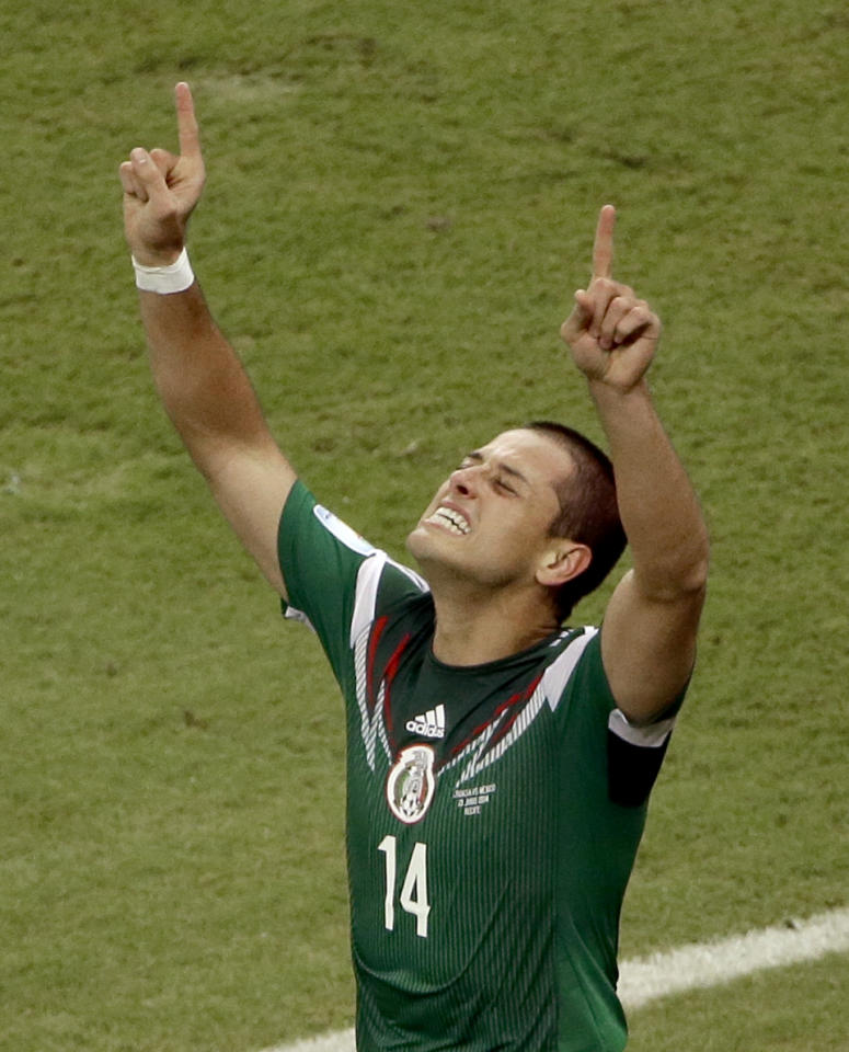 Mexico's Javier Hernandez (14) celebrates scoring his side's 3rd goal during the group A World Cup soccer match between Croatia and Mexico at the Arena Pernambuco in Recife, Brazil, Monday, June 23, 2014. (AP Photo/Hassan Ammar)