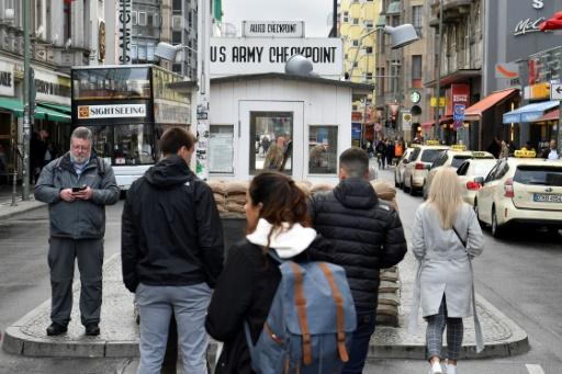 Tourists have flocked to Checkpoint Charlie since the reunification of Germany