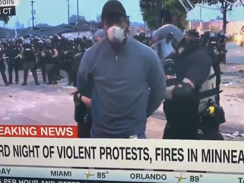 CNN reporter Omar Jimenez and other members of his television crew were arrested by police live on air while covering the Minneapolis protests over the death of black man George Floyd, 29 May 2020: CNN