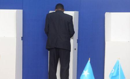A Somali lawmaker marks his ballot in a booth during the presidential vote at the airport in Somalia's capital Mogadishu, February 8, 2017. REUTERS/Feisal Omar