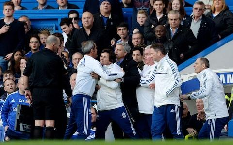 Chelsea assistant first team coach Rui Faria (C) clashes with referee Mike Dean after Sunderland score their second goal from a penalty as manager Jose Mourinho looks on - Credit: Action Images/Tony O'Brien