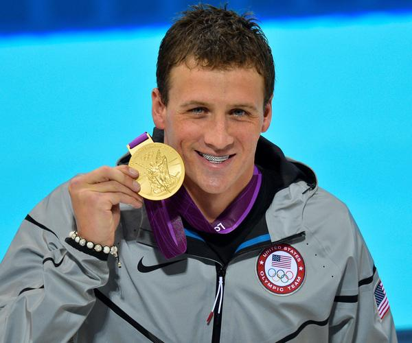 Ryan Lochte's grills and sneakers are insane. Love 'em or hate 'em, you gotta give the guy credit for backing his brilliant swimming (two golds, two silvers, and one bronze) with some fashionable antics. Word is he wants to work in fashion when he retires from swimming.  Ryan Lochte; Photo by Keystone Press