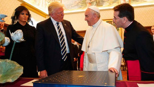 PHOTO: Pope Francis exchanges gifts with President Donald Trump and First Lady Melania Trump during a private audience at the Vatican on May 24, 2017. President Trump met Pope Francis at the Vatican today in their first face-to-face encounter. (Evan Vucci/AFP/Getty Images)
