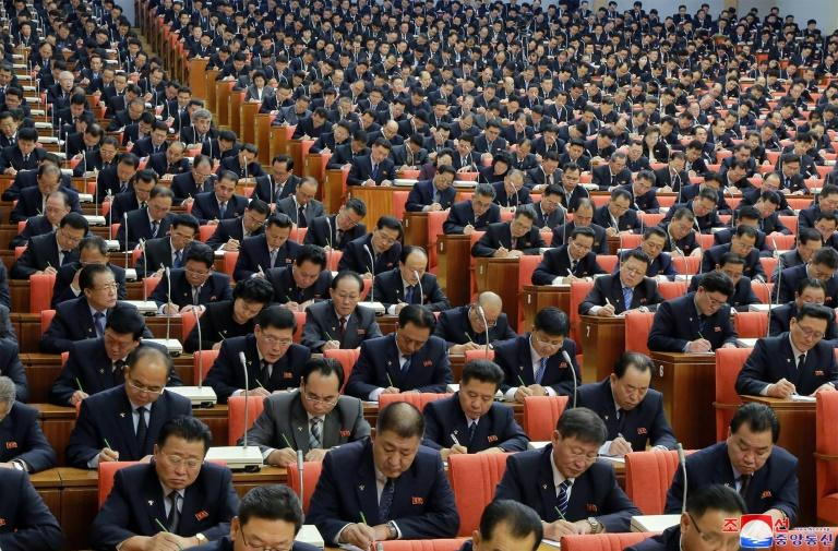 Members of North Korea's Workers' Party take notes during leader Kim Jong Un's marathon seven-hour speech in Pyongyang