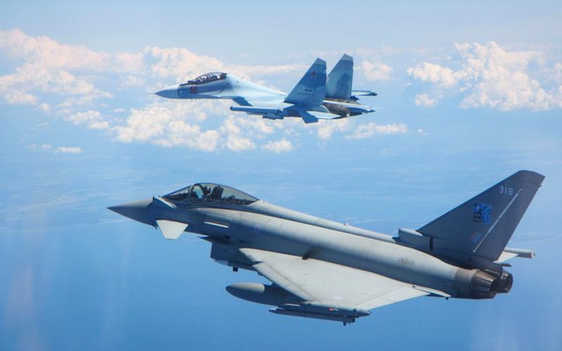 The RAF Typhoon (foreground) was scrambled to intercept the Russian SU-30 Flanker fighter jet in the Estonia/Finland area - REX