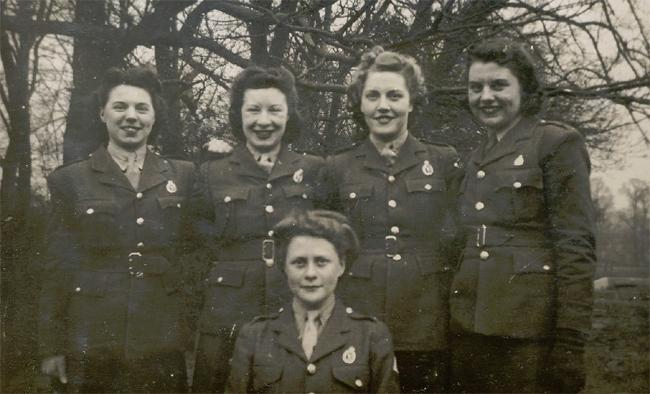 "<span></span>   <span>Winifred Sirois (2nd from the left) in Garrett's Hay, near Woodhouse Eaves, England, 1943. Photo courtesy of <a href=""http://www.thememoryproject.com/stories/347:winifred-kathleen-sirois/"" target=""_blank"">Historica-Dominion Institute</a>.</span>  <p class=""MsoNormal"">    </p>"