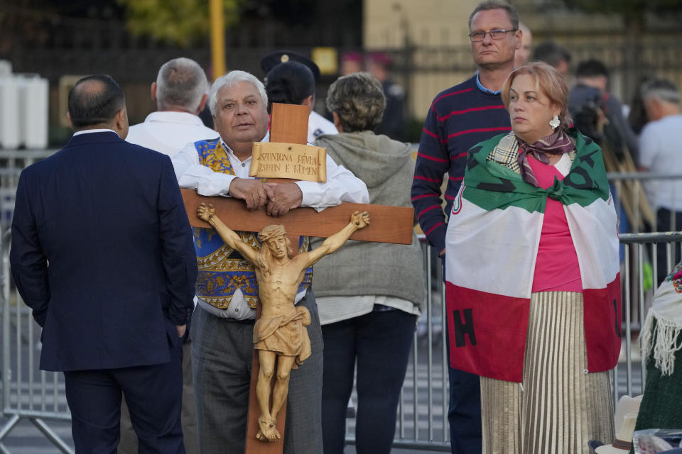 People wait for the arrival of Pope Francis to celebrate mass in Heroes' Square, Budapest, Sunday, Sept. 12, 2021. Francis is opening his first foreign trip since undergoing major intestinal surgery in July, embarking on an intense, four-day, two-nation trip to Hungary and Slovakia that he has admitted might be overdoing it. (AP Photo/Vadim Ghirda)