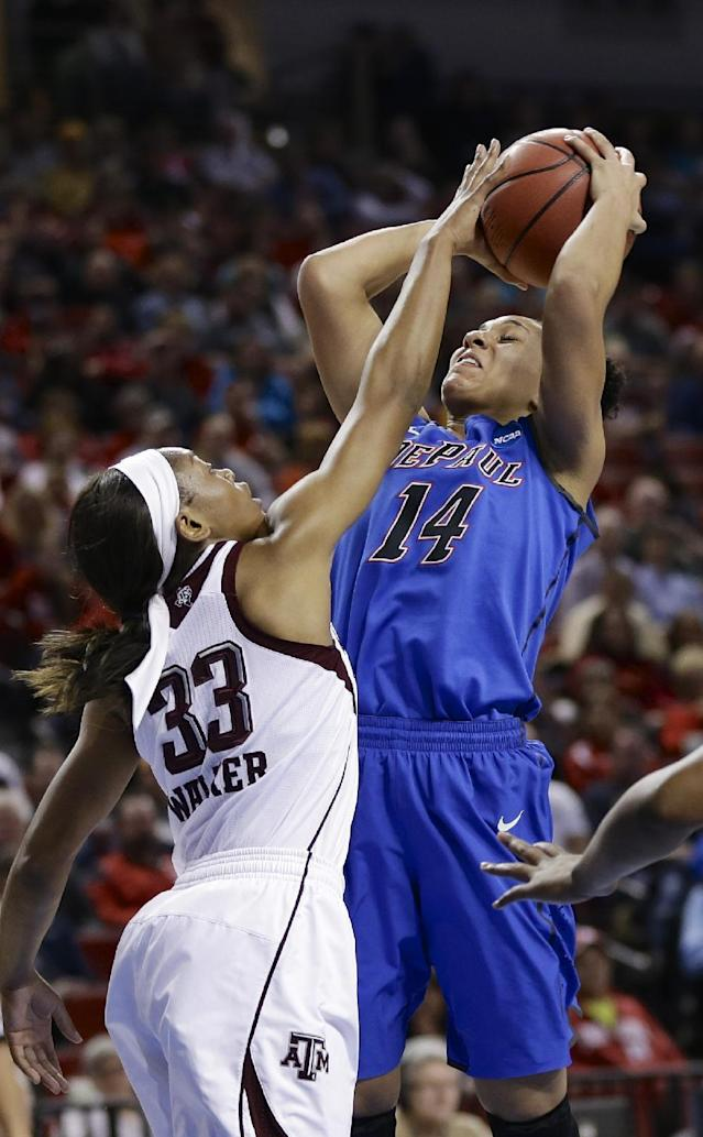 Texas A&M's Courtney Walker (33) blocks a shot by DePaul's Jessica January (14) during the first half of a regional semifinal in the NCAA college basketball tournament in Lincoln, Neb., Saturday, March 29, 2014. (AP Photo/Nati Harnik)
