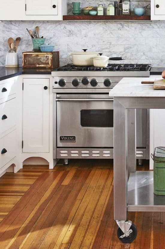 <p>A mix of attractive neutrals, including marble subway tile, make for a charming kitchen design scheme.</p>