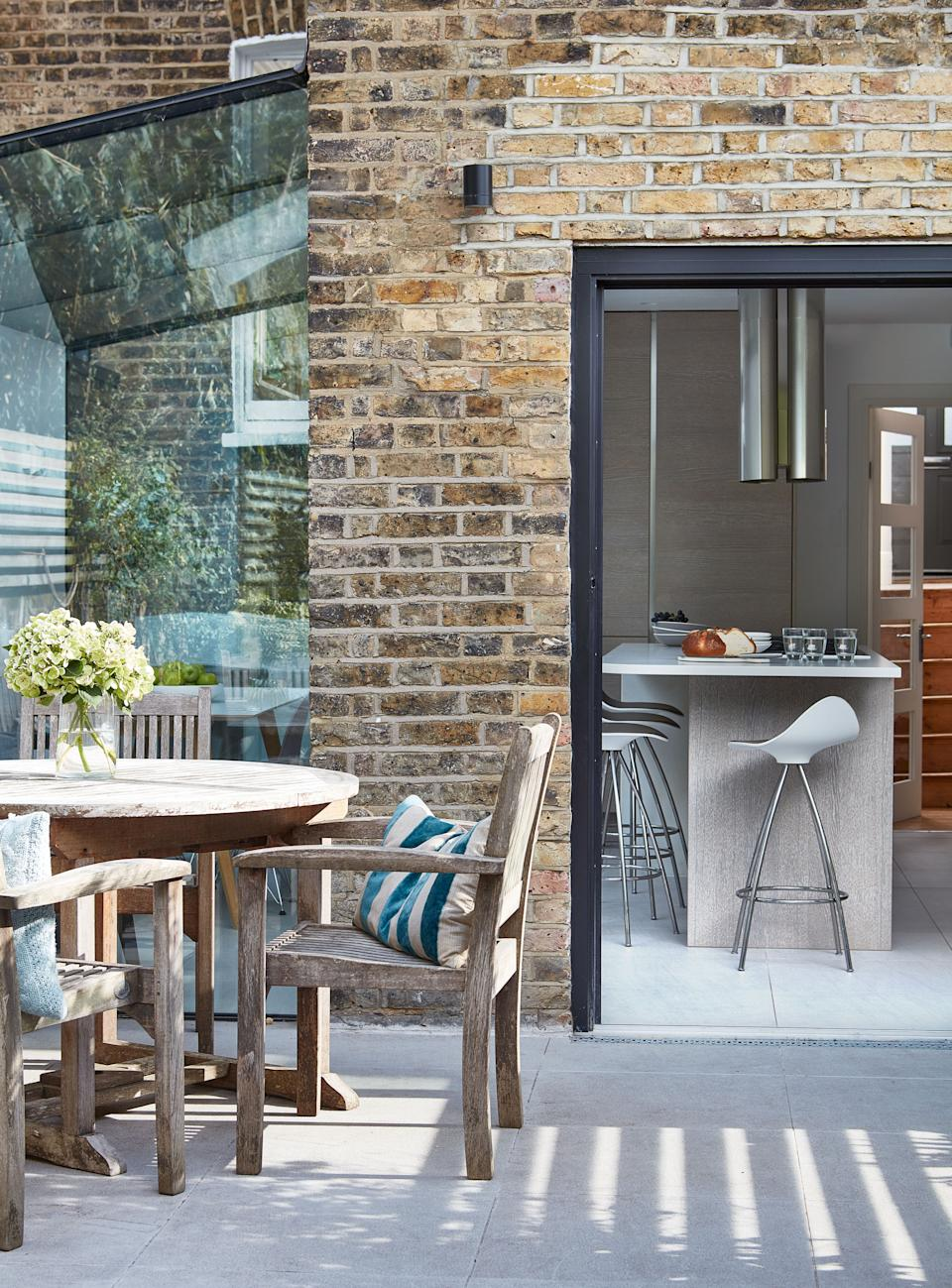 Sarah Brooks' kitchen has been improved by adding a glass box style extension to the side of her London home