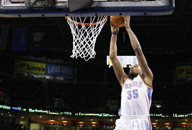 Oklahoma City Thunder small forward Kevin Durant (35) goes up for a dunk against the Golden State Warriors during the first half of an NBA basketball game Friday, Jan. 17, 2014, in Oklahoma City. (AP Photo/Alonzo Adams)