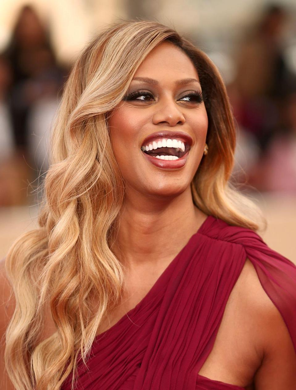 """<p>She rose to fame via <em>Orange is the New Black</em>, but Laverne Cox is a true blonde bombshell on the red carpet. Here, she rocks voluminous, honeyed, soft blonde waves with subtle """"root melt""""—meaning her hair is darker at the roots, giving a deeper, luxurious, layered look.</p>"""