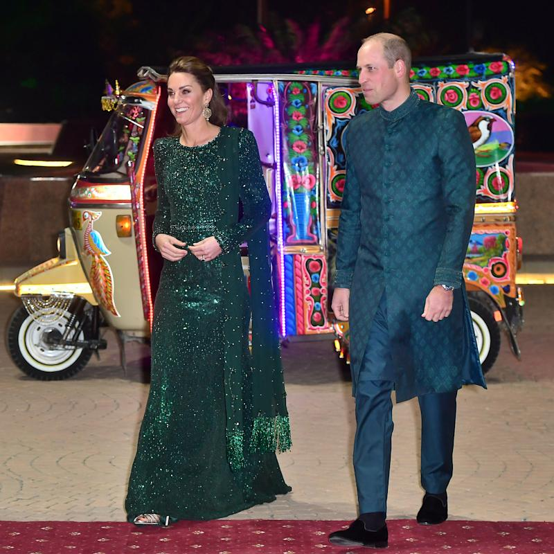 Prince William, Duke of Cambridge and Catherine, Duchess of Cambridge wear green as a nod to Pakistan's flag. [Photo: Getty]