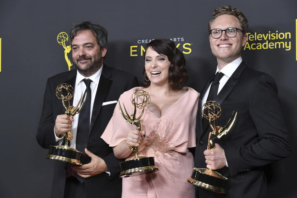 "FILE - This Sept. 14, 2019 file photo shows Adam Schlesinger, from left, Rachel Bloom and Jack Dolgen in the press room with the awards for outstanding original music and lyrics for ""Crazy Ex Girlfriend"" at the Creative Arts Emmy Awards in Los Angeles. Schlesinger, an Emmy and Grammy winning musician and songwriter known for his band Fountains of Wayne and his songwriting on the TV show ""Crazy Ex-Girlfriend,"" has died from coronavirus at age 51. (Photo by Richard Shotwell/Invision/AP, File)"