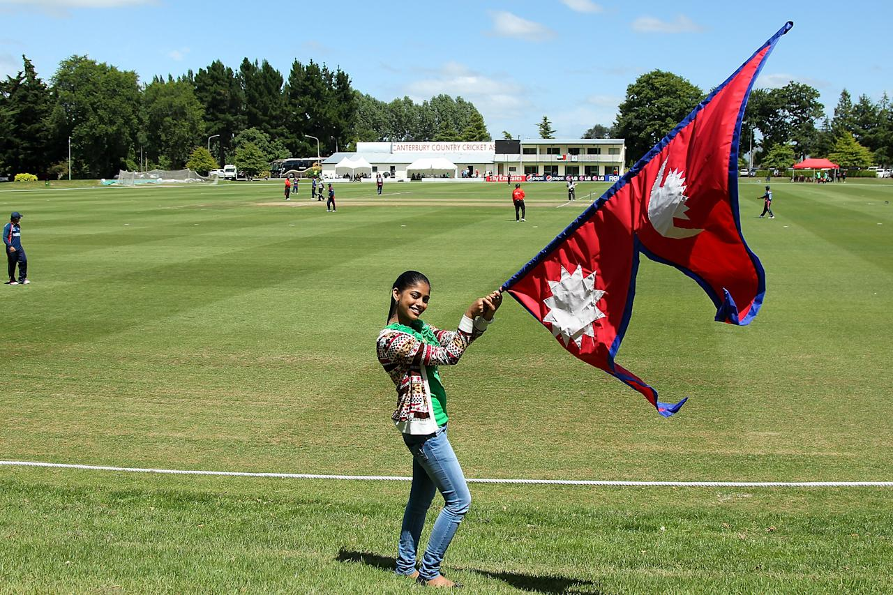 RANGIORA, NEW ZEALAND - JANUARY 13: A young Nepalese girls shows her support during the ICC Cricket World Cup Qualifier match between UAE and Nepal on January 13, 2014 in Rangiora, New Zealand.  (Photo by Martin Hunter-IDI/IDI via Getty Images)