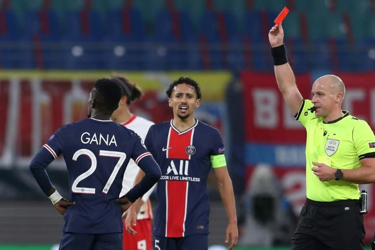 Idrissa Gueye (L) was one of two players sent off for PSG in Germany
