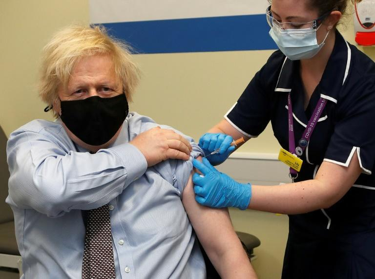 Britain's Prime Minister Boris Johnson receives the AstraZeneca vaccine, hoping to reassure citizens of its safety