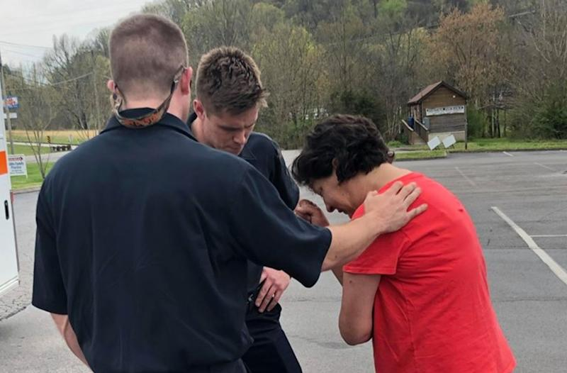 First responders with Knox County Rural Metro stopped immediately to pray with a woman who needed comfort. (Photo: Facebook)