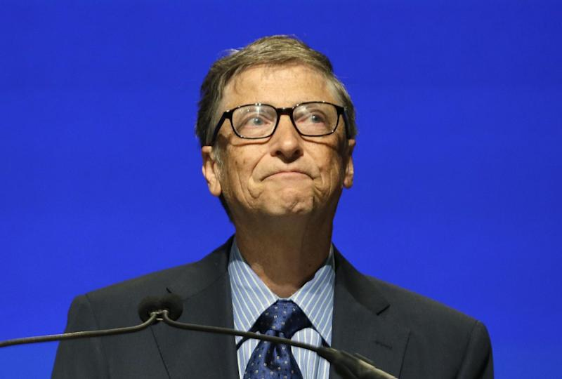 Microsoft chairman Bill Gates chokes up as he end his remarks at the company's annual shareholders meeting Tuesday, Nov. 19, 2013, in Redmond, Wash. Gates was reading from prepared remarks during Steve Ballmer's final shareholders meeting as chief executive. (AP Photo/Elaine Thompson)