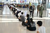 Thai airport workers wait to receive Covid jabs as the country prepares to open its all-important tourism industry