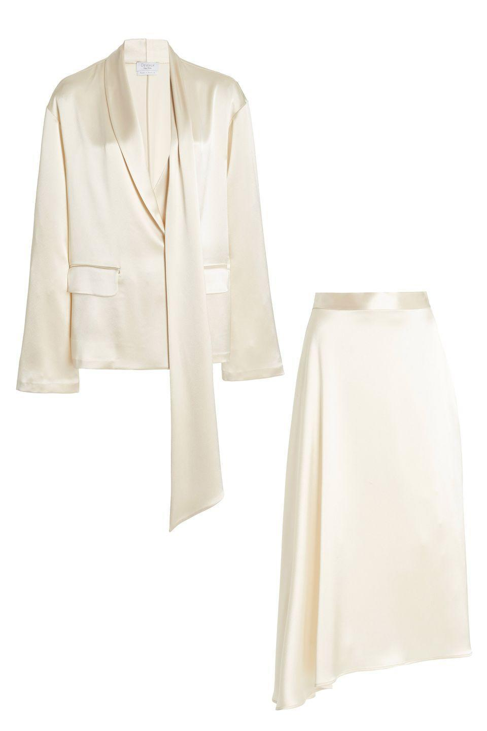 "<p>A midi skirt paired with a coordinating jacket is a chic, fresh take on the mod skirt suit. This one in satin would feel sexy with a sky-high heel, and dainty for daytime with a slide, mule, or flat.</p><p><em>Sheila blazer, $795, <a href=""https://www.modaoperandi.com/women/p/deveaux/sheila-draped-oversized-satin-blazer/443857"" rel=""nofollow noopener"" target=""_blank"" data-ylk=""slk:modaoperandi.com"" class=""link rapid-noclick-resp"">modaoperandi.com</a></em> <a class=""link rapid-noclick-resp"" href=""https://go.redirectingat.com?id=74968X1596630&url=https%3A%2F%2Fwww.modaoperandi.com%2Fwomen%2Fp%2Fdeveaux%2Fsheila-draped-oversized-satin-blazer%2F443857&sref=https%3A%2F%2Fwww.harpersbazaar.com%2Fwedding%2Fbridal-fashion%2Fg35154193%2Fbest-wedding-suits-for-women%2F"" rel=""nofollow noopener"" target=""_blank"" data-ylk=""slk:SHOP"">SHOP</a></p><p><em>Merel skirt, $695, <a href=""https://www.modaoperandi.com/women/p/deveaux/merel-asymmetric-draped-satin-midi-skirt/443858"" rel=""nofollow noopener"" target=""_blank"" data-ylk=""slk:modaoperandi.com"" class=""link rapid-noclick-resp"">modaoperandi.com</a></em> <a class=""link rapid-noclick-resp"" href=""https://go.redirectingat.com?id=74968X1596630&url=https%3A%2F%2Fwww.modaoperandi.com%2Fwomen%2Fp%2Fdeveaux%2Fmerel-asymmetric-draped-satin-midi-skirt%2F443858&sref=https%3A%2F%2Fwww.harpersbazaar.com%2Fwedding%2Fbridal-fashion%2Fg35154193%2Fbest-wedding-suits-for-women%2F"" rel=""nofollow noopener"" target=""_blank"" data-ylk=""slk:SHOP"">SHOP</a></p>"