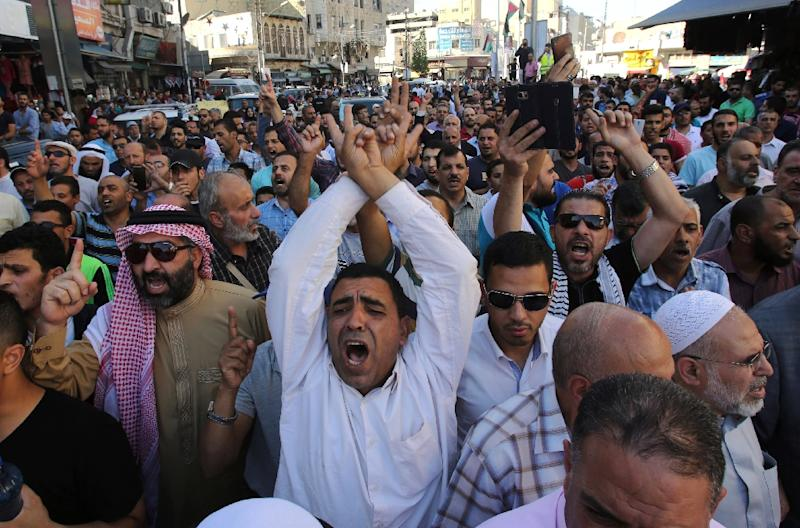 The closure of the mosque compound, Islam's third holiest shrine, angered Muslims with protests in Jordan which is custodian of the site (AFP Photo/KHALIL MAZRAAWI)