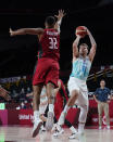Slovenia's Luka Doncic (77) shoots over Germany's Johannes Thiemann (32) during men's basketball quarterfinal game at the 2020 Summer Olympics, Tuesday, Aug. 3, 2021, in Saitama, Japan. (AP Photo/Charlie Neibergall)