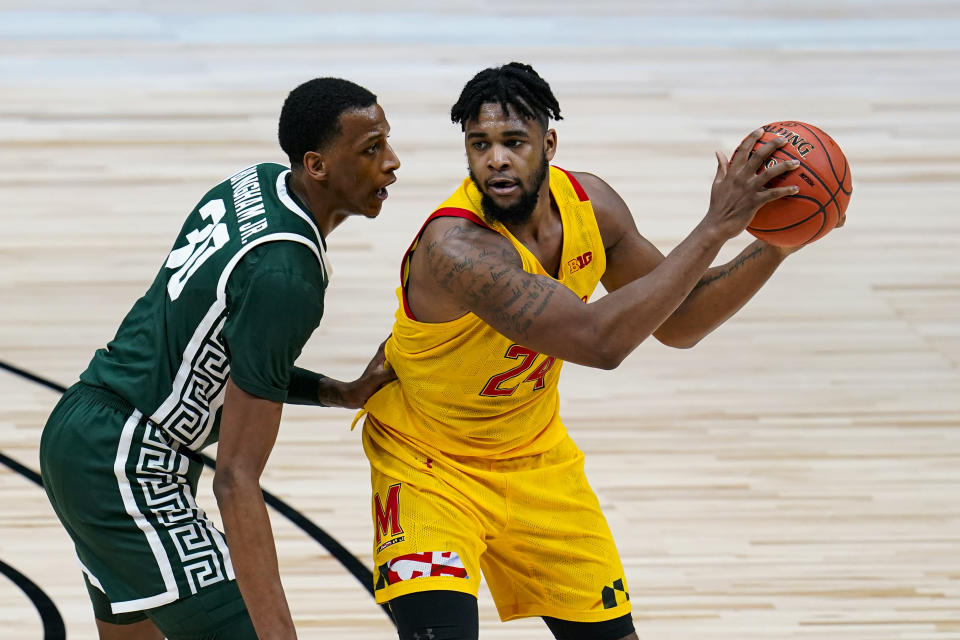 Maryland forward Donta Scott (24) is defended by Michigan State forward Marcus Bingham Jr. (30) in the second half of an NCAA college basketball game at the Big Ten Conference tournament in Indianapolis, Thursday, March 11, 2021. (AP Photo/Michael Conroy)