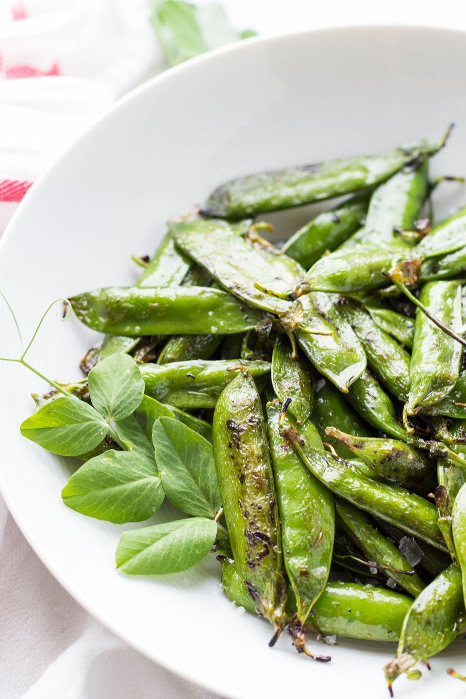 """<p>This the easiest-ever recipe for salted grilled peas in the pod, and it'll look beautiful on your table! </p><p><strong>Get the recipe at <a href=""""https://coleycooks.com/grilled-peas/"""" rel=""""nofollow noopener"""" target=""""_blank"""" data-ylk=""""slk:Coley Cooks"""" class=""""link rapid-noclick-resp"""">Coley Cooks</a>.</strong> </p><p><a class=""""link rapid-noclick-resp"""" href=""""https://go.redirectingat.com?id=74968X1596630&url=https%3A%2F%2Fwww.walmart.com%2Fip%2FThe-Pioneer-Woman-Timeless-Pre-Seasoned-Plus-10-25-Cast-Iron-Grill-Pan%2F137034757&sref=https%3A%2F%2Fwww.thepioneerwoman.com%2Ffood-cooking%2Fmeals-menus%2Fg32188535%2Fbest-grilling-recipes%2F"""" rel=""""nofollow noopener"""" target=""""_blank"""" data-ylk=""""slk:SHOP PRE-SEASONED GRILL PANS"""">SHOP PRE-SEASONED GRILL PANS</a></p>"""