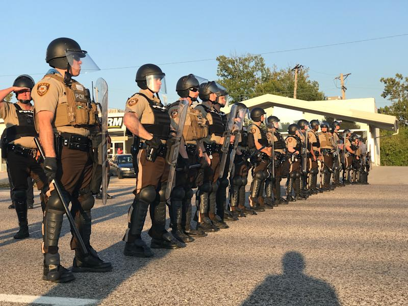 Riot police stand in a line near protesters in St. Louis County. (Ryan J. Reilly / HuffPost)