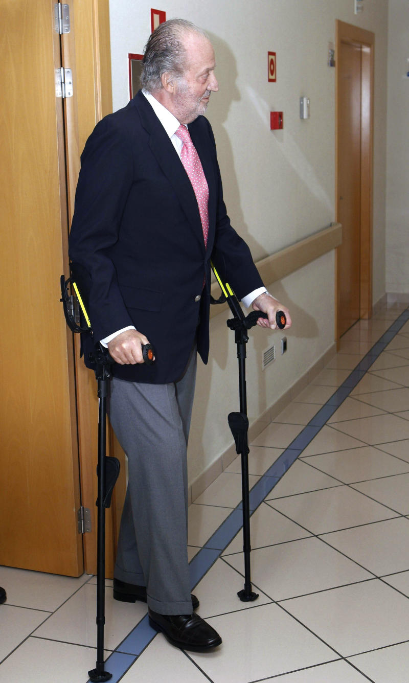Spain's King Juan Carlos walks on crutches before leaving a hospital in Madrid Sunday June 5, 2011. Doctors say King Juan Carlos is free to leave the hospital two days after successfully undergoing knee replacement surgery, an operation that sparked alarm about his overall health, irking the monarch. The king is able to take some steps after receiving titanium implants in his right knee, Madrid's San Jose Hospital said Sunday. The knee replacement corrects the lingering consequences of a past sports accident. (AP Photo/ Angel Diaz, Pool)